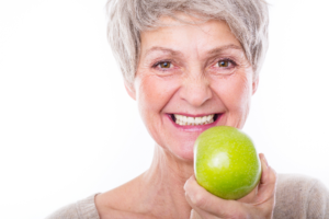 Older woman holding apple