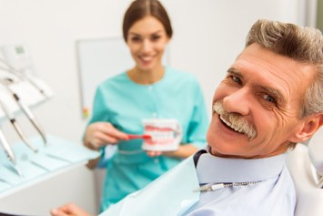 Smiling senior man at dental office